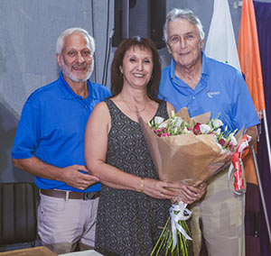 Inductions event coordinator Sharon Talmor, center, is celebrated by HOF Executive Director Effi Yaacobi, left, and HOF Founder Joe Siegman